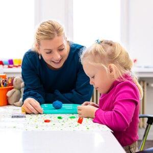 teacher plays with a child
